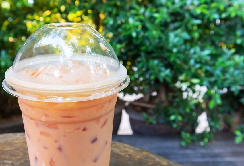 Ice of thai tea milk with nature background Drink Drinking Glass Focus On Foreground Food And Drink Freshness Refreshment Table Thai Tea Milk
