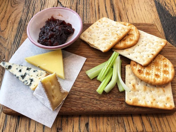 Cheeseboard Crackers Celery Chutney Food Food And Drink Healthy Eating Freshness High Angle View SLICE Wood - Material No People Table Still Life Cheese Indoors  Dairy Product Ready-to-eat Cutting Board Close-up Directly Above
