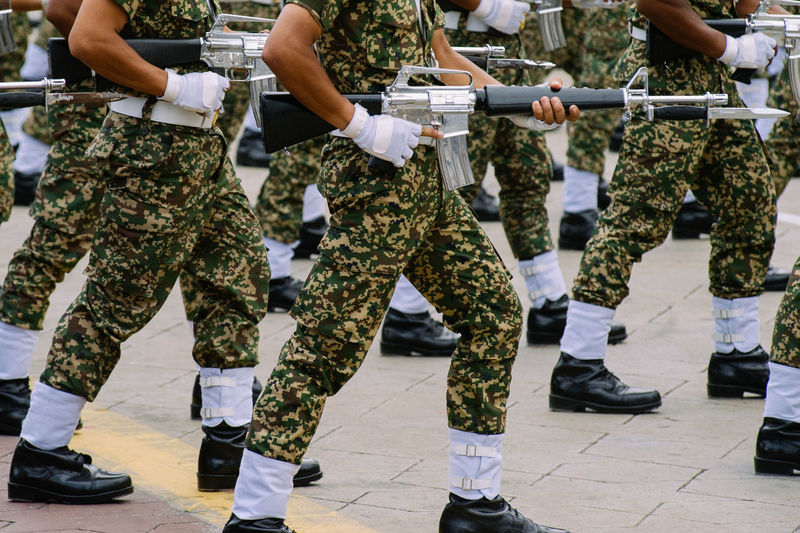 Low section of army soldiers with rifle during parade