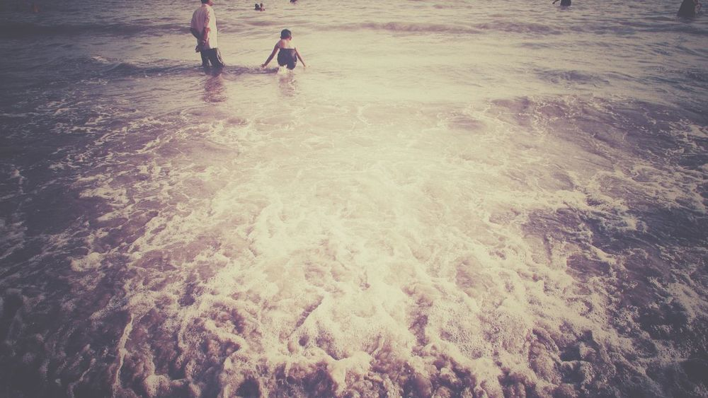 Nostalgic image of childhood's innocence and playfulness. Nostalgic  Nostalgia Innocence Childhood Playfulness Water Wave Shore Sandy Beach Sand Calm Ocean Beach Surf Rushing Horizon Over Water Ankle Deep In Water