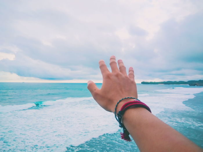 Give me a cloud. Travel Exploring Backpacker Landscape Potrait Colors Blue INDONESIA ASIA Blue Sky Nature Human Hand Water Sea Beach Human Arm Palm Sky Close-up Horizon Over Water Cloud - Sky
