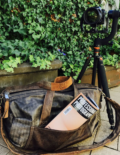Camera - Photographic Equipment Close-up Day Equipment Growth Magazine No People Outdoors Photo Plant Potted Plant Set-up Text Tripod
