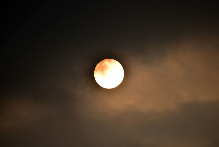 Low angle view of moon against sun