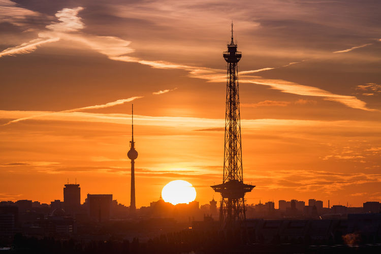 Silhouette Fernsehturm And Television Tower Against Dramatic Sky During Sunset