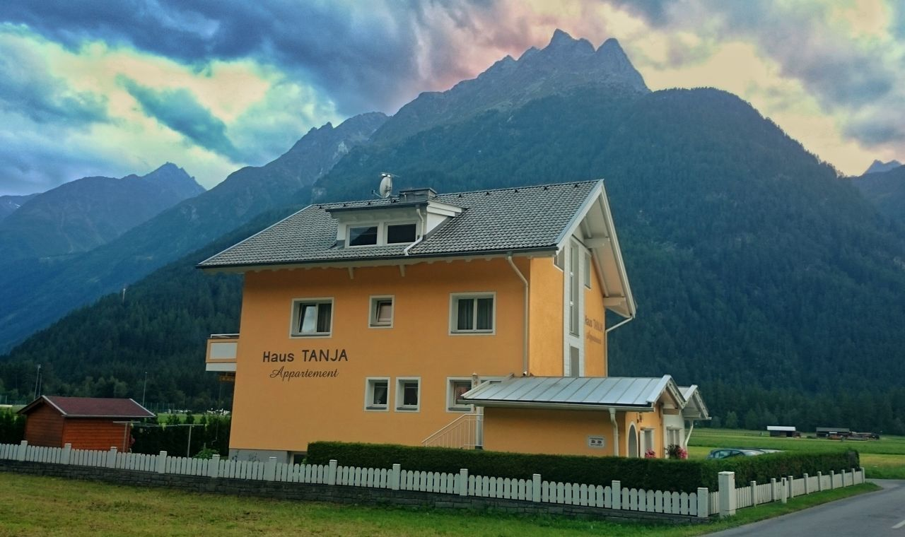 mountain, architecture, building exterior, built structure, house, sky, mountain range, no people, cloud - sky, residential building, day, nature, scenics, outdoors, beauty in nature