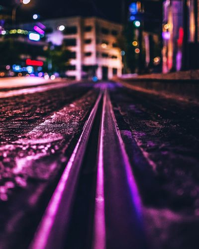 Surface level of railroad tracks at night