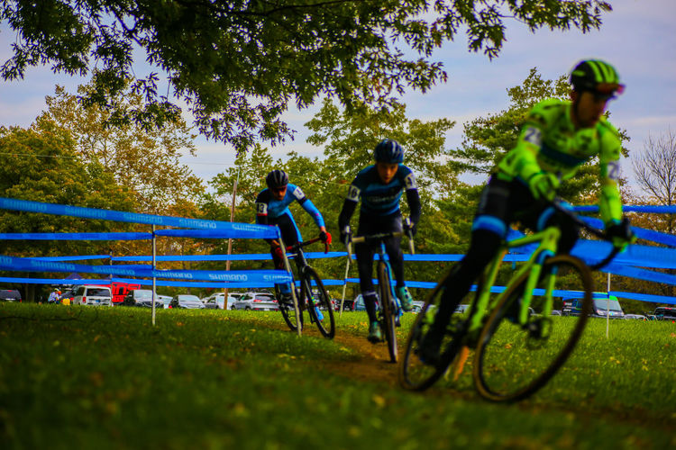 EyeEmNewHere Second Acts Bicycle Sport Adventure Nature Sports Race Tree Cycling Outdoors Togetherness Competition Healthy Lifestyle Adults Only People Day Sports Clothing Challenge Sportsman Adult Only Men Racing Bicycle Cyclocross Race Cyclocross Inner Power Go Higher