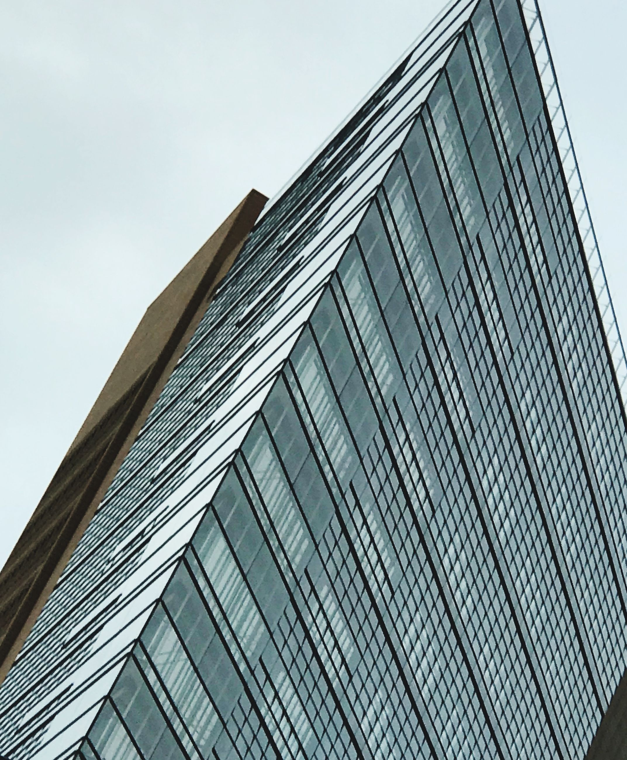 architecture, built structure, building exterior, low angle view, modern, window, no people, outdoors, sky, skyscraper, city, day