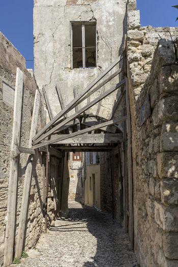 Traditional street of old town, Rhodes, Greece Architecture Old Town Streets Rhodes Greece Ancient Buildings Arch Byzantine Influenze Cobbled Street Day Dilapidated Building No People Old Town, Rhodes Outdoors Ruined Building