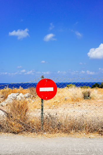 Do not enter sign at beach against sky