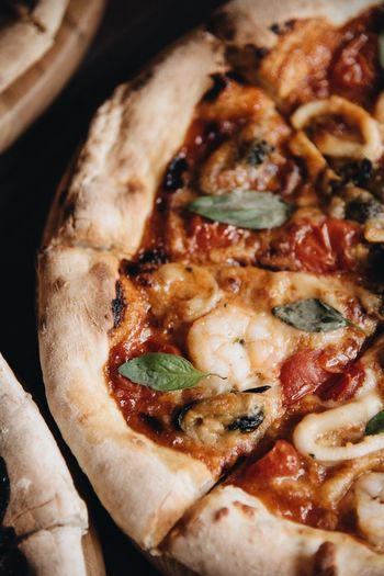 Seafood pizza Pizza Food And Drink Food Ready-to-eat Indoors  Freshness Close-up Still Life High Angle View No People Indulgence Unhealthy Eating Cheese Vegetable Dairy Product Focus On Foreground Bread Pizza Temptation Wellbeing Snack