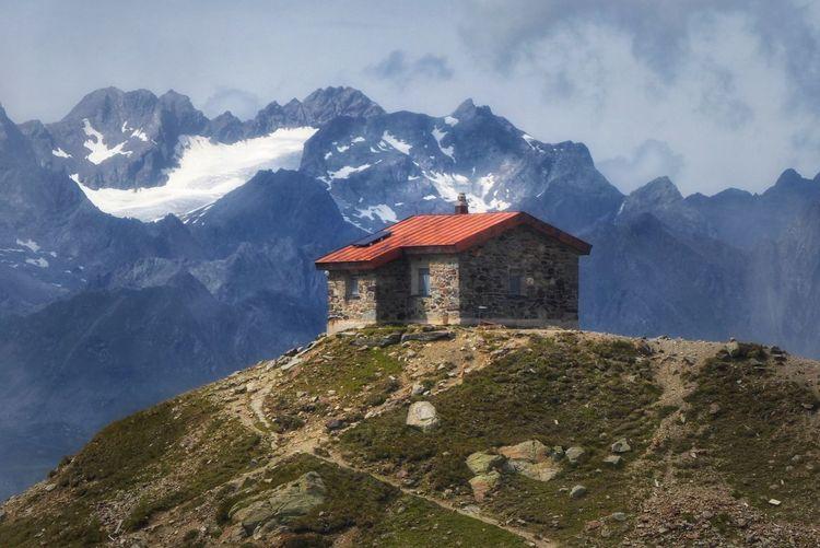 Building on mountain against sky