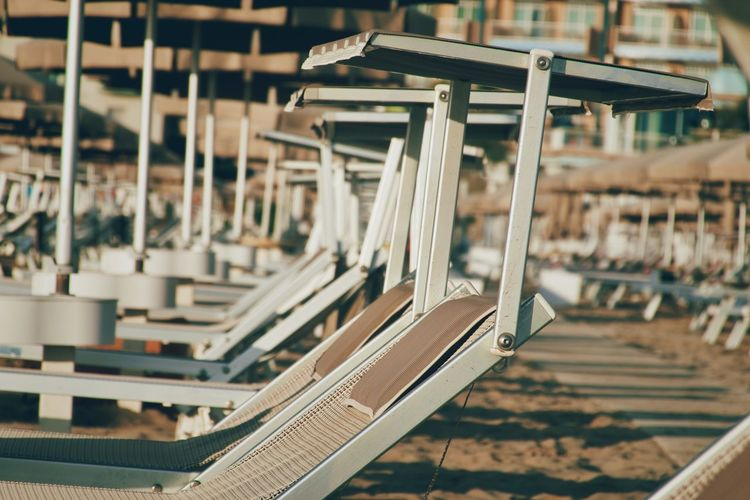 Close-up of empty beach chairs