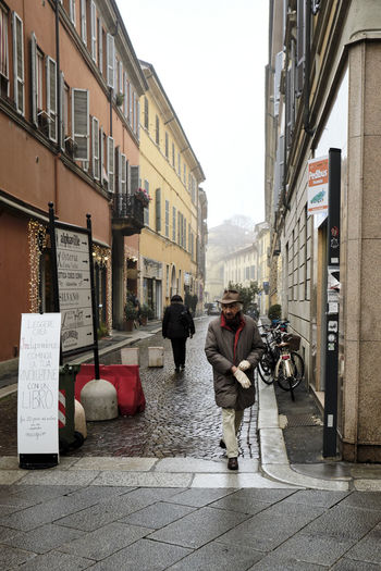 Piacenza, Italy - December 2018 Piacenza Building Exterior Architecture Street People Candid Glove Cold Temperature Mist Nebbia Outdoors Lifestyles Footpath Italy My Best Photo