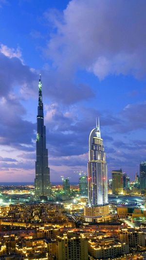 Modern Skyscraper Urban Skyline Architecture Cloud - Sky Night Illuminated Cityscape Building Exterior Downtown District City Office Building Exterior Travel Destinations Tower Business Finance And Industry Sky City Life Outdoors No People Built Structure Dubai EyeEmNewHere