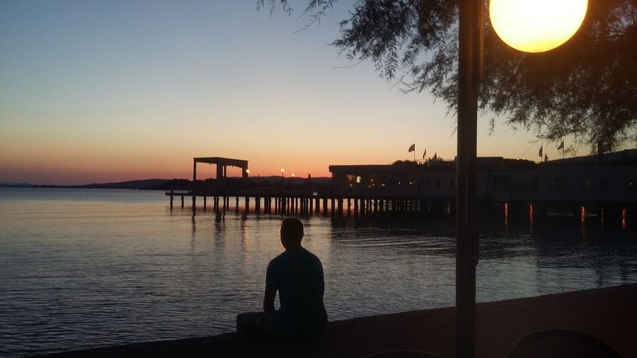 Silhouette Water Beauty In Nature Orange Color Sunset My Son ❤ Italia Passignano Sul Trasimeno Passignano Love Nature Outdoors Sky