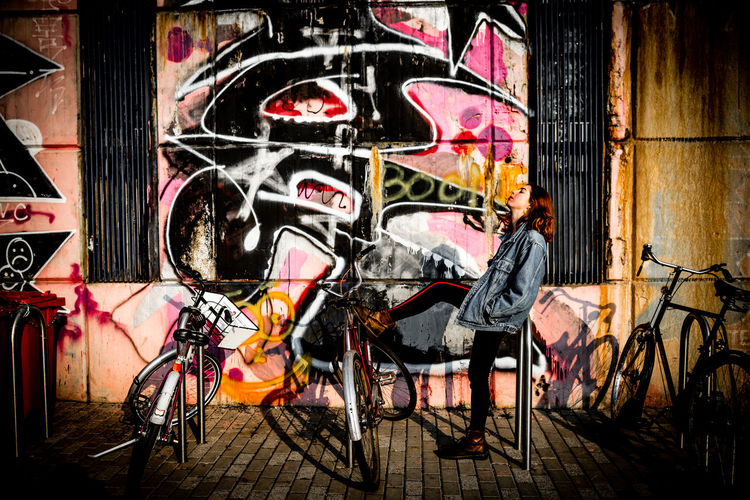 Graffiti on bicycle against wall at night