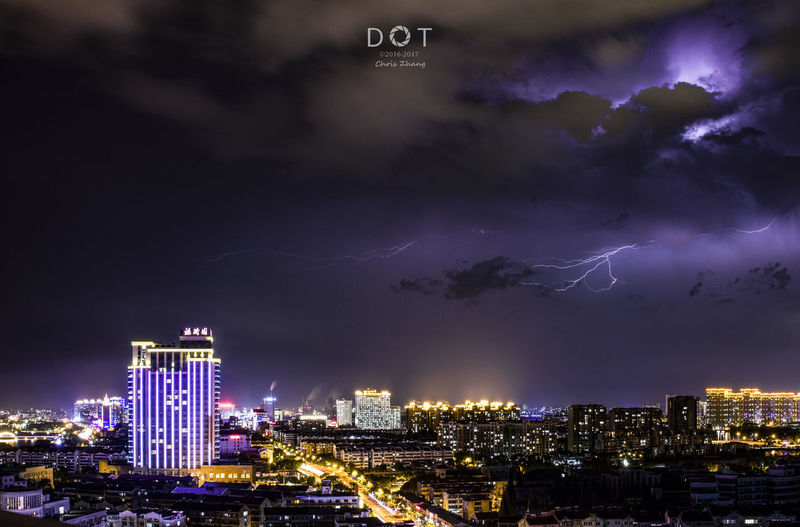 lightning Night Cityscape City Skyscraper Urban Skyline Lightning Architecture Thunderstorm Sky Modern Illuminated Building Exterior Downtown District Built Structure No People Outdoors Futuristic Neon Forked Lightning