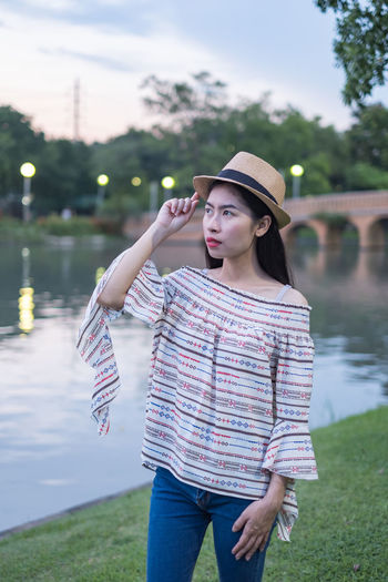 asian woman tourists. he is posing for a model fashion concept. in the park and tourist attractions. happily during travel the holidays and relax. Smile Woman Travel Asian  Landmark Picture Female Background Portrait Young Adult City Tourism Vacation Thailand person Happy Summer Outdoor Beautiful Bangkok Holiday Relax Hat Place Of Worship Attractions Girl Traveler Tourist Journey Technology Adventure People Lifestyles Trip Traveller Concept Nature Talking Lawn Grass Public Park Fashion Models One Person Standing Clothing Outdoors Beautiful Woman Young Women