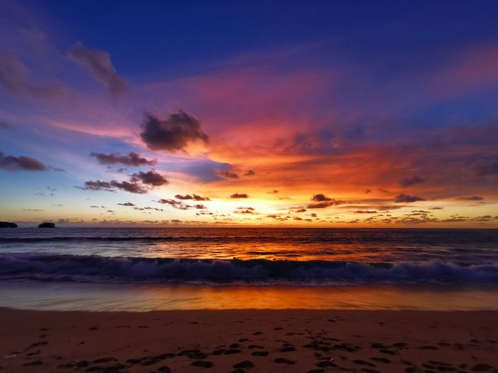 Colorful sky at the beach Water Low Tide Sea Wave Sunset Beach Sand Sunlight Tide Dramatic Sky Romantic Sky Seascape Horizon Over Water Coastline Ocean Sandy Beach Atmospheric Mood