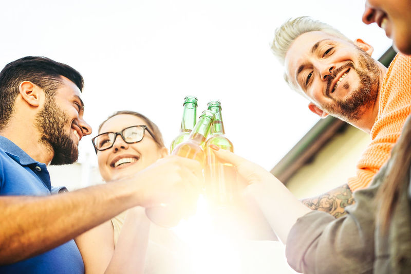 Happy friends cheering with beer People Bar Happy Group Of People Young Adult Youth Hanging Out Drinking Drink Smiling Happiness Emotion Togetherness Alcohol Men Young Men Adult Holding Friendship Celebratory Toast Celebration Beard Facial Hair Casual Clothing Glass