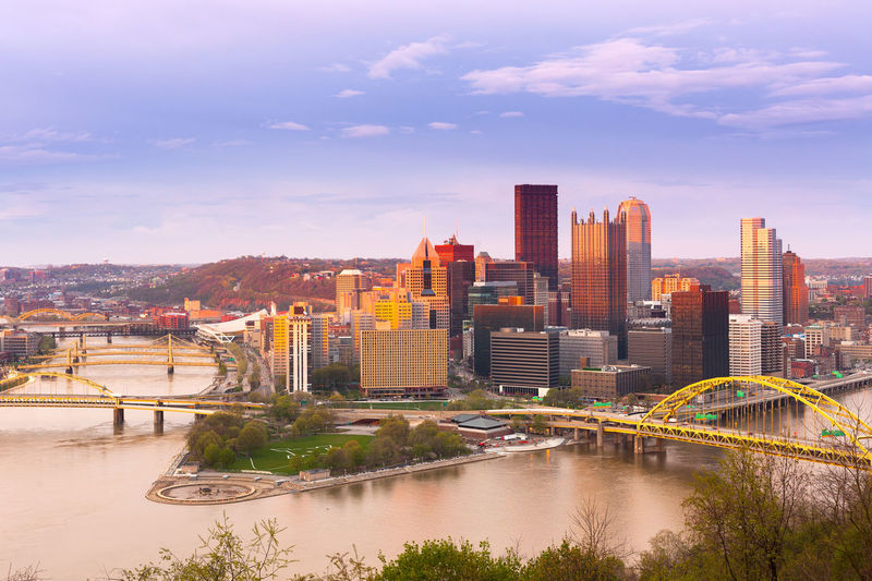 Panoramic view of Pittsburgh and the 3 rivers, Pittsburgh, Pennsylvania, USA Monongahela River Ohio River Pennsylvania Pittsburgh Skyline USA Above Allegheny River Architecture Building Exterior Built Structure Central Business District City Cityscape Dusk Modern Point State Park River Skyscraper Sunset Travel Destinations Urban Skyline Water Waterfront
