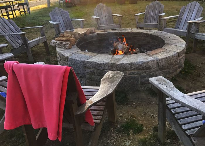 Fire pit and adirondack chairs. Waiting for guests. Fire Pit Adirondack Chairs Burning Wood - Material Fire Fire Pit Chair Outdoors Guests Gathering Visitors Friends Horizontal