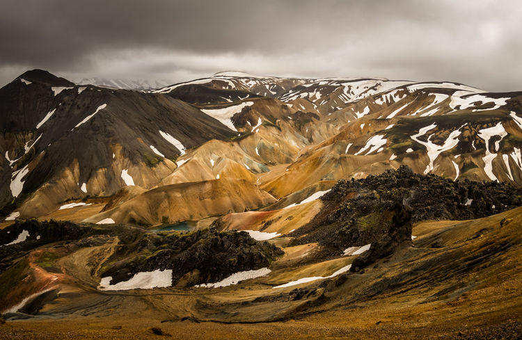 ISO100 17mm f/7.1 1/160s Landmanalaugar Iceland Mountain Colors Colored Background Snow Volcano Cloud - Sky Environment Landscape Scenics - Nature Cold Temperature Sky Mountain Range Nature Winter No People Beauty In Nature Snowcapped Mountain Land Non-urban Scene Wilderness Travel Destinations Travel Outdoors Mountain Peak