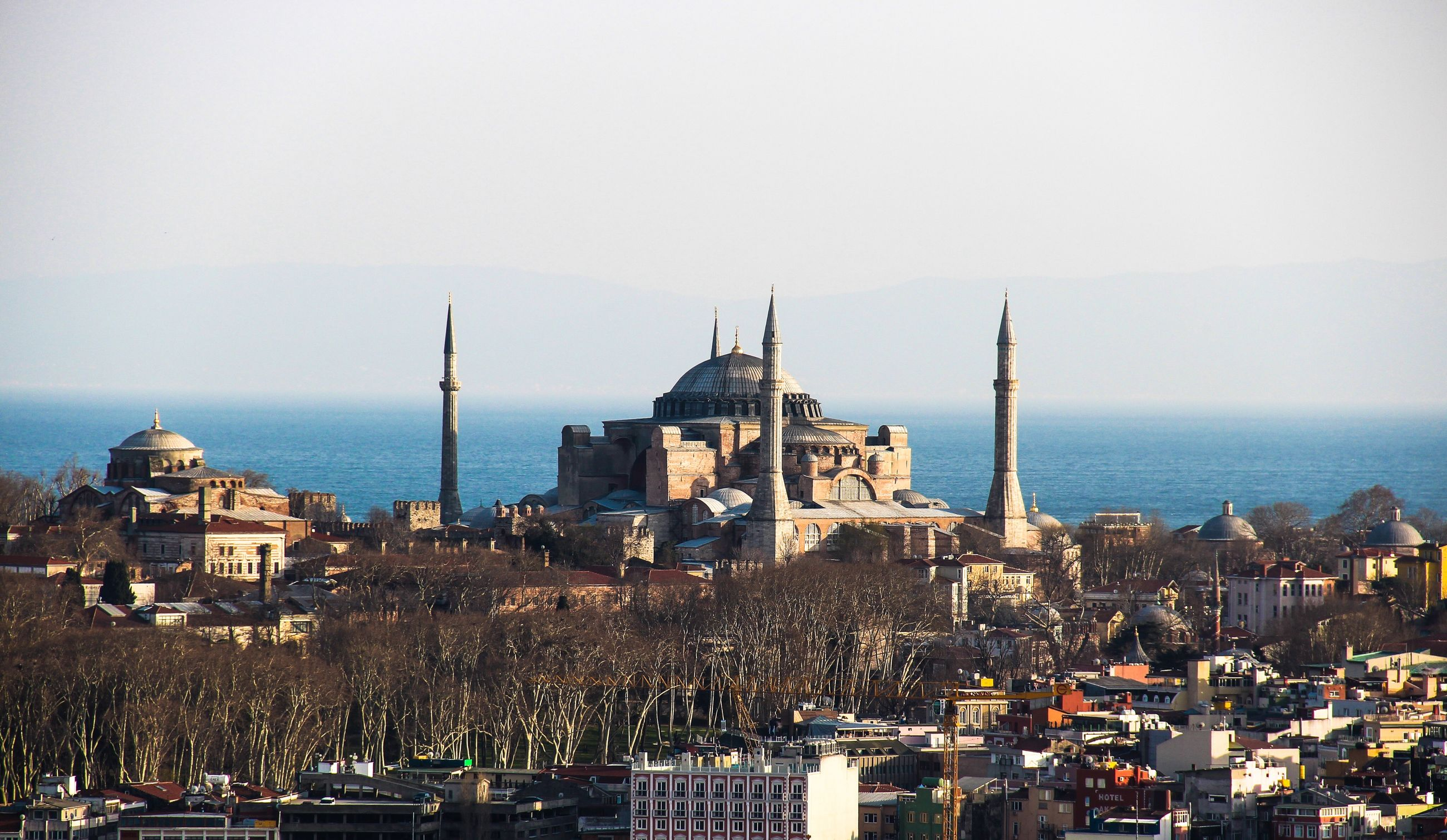 architecture, building exterior, built structure, sky, dome, city, place of worship, large group of people, outdoors, day