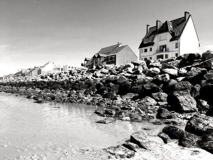 Wissant 6, Côte d'Opale Lenkacam ShotOnIphone IPhone Black And White Photography Black & White Black And White France Côte D'Opale Opale Coast Wissant Rocks And Water Architecture Built Structure Building Exterior House Water Beach Sky Sea Clear Sky Outdoors Nature