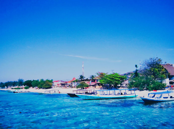 Gili Trawangan, Lombok, Indononesia. Water Nautical Vessel Transportation Mode Of Transportation Sky Blue Waterfront Sea Nature Day Copy Space Travel Tree Architecture Plant Building Exterior Built Structure Outdoors Incidental People Passenger Craft Yacht Luxury Sailboat Nature Beauty In Nature