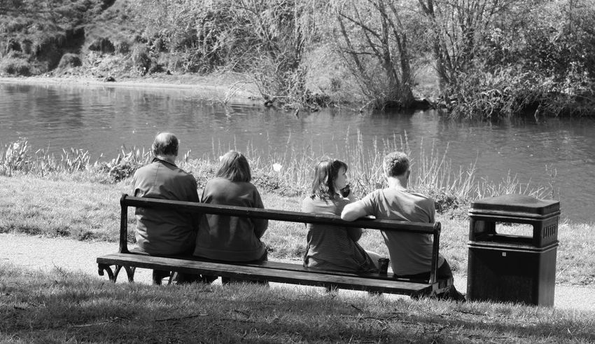 Beauty In Nature Bench Black And White Blackandwhite Blackandwhite Photography Day Grass Lakeshore Leisure Activity Men Monochrome Nature Outdoors People Real People Rear View River Riverbank Riverside Sitting Togetherness Tree Water Long Goodbye TCPM The Great Outdoors - 2017 EyeEm Awards Neighborhood Map