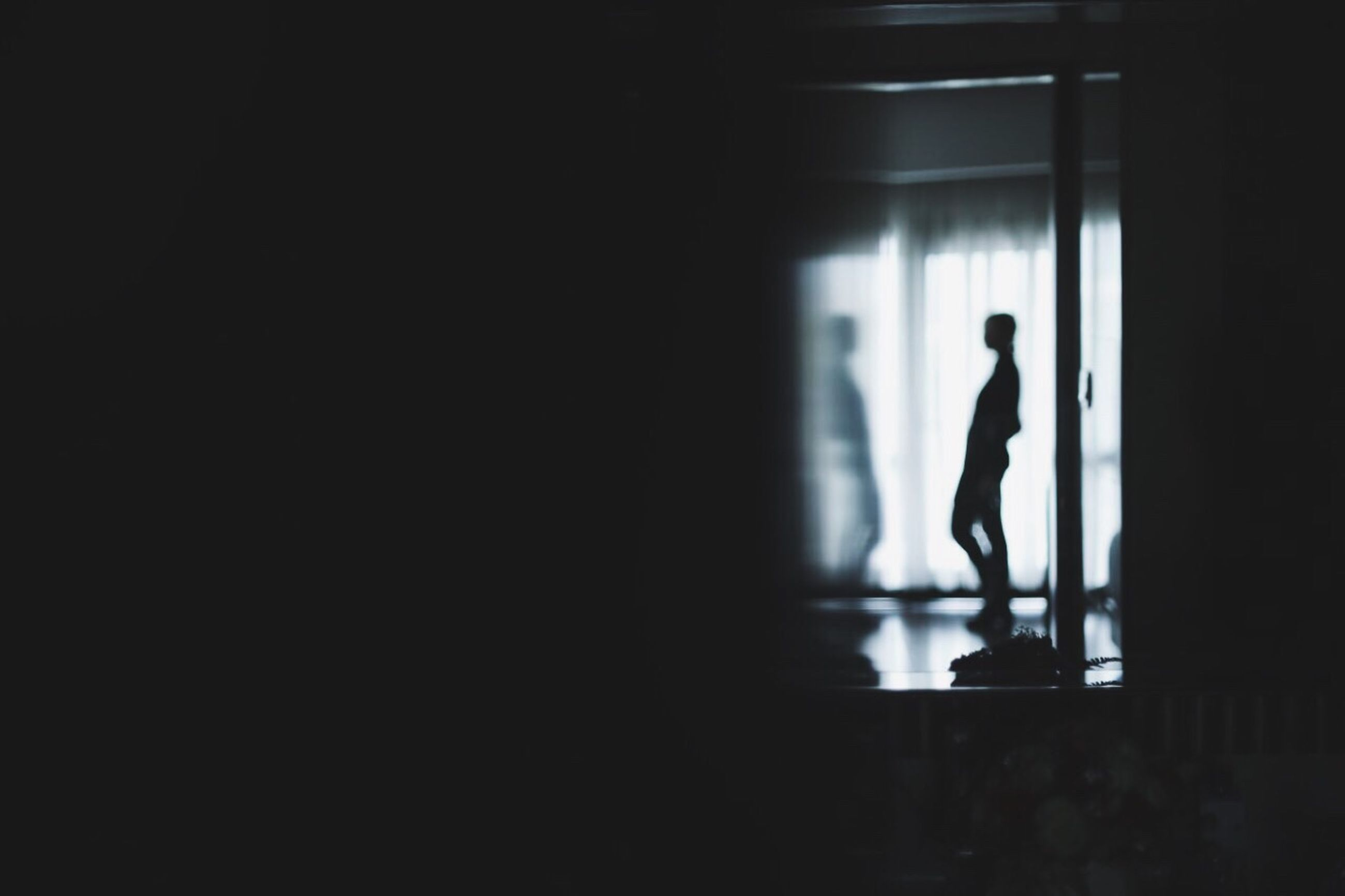 copy space, one person, indoors, dark, silhouette, men, one man only, standing, adults only, people, adult, only men, young adult, day
