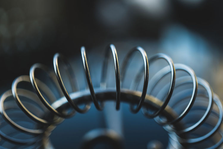Cable Close-up Coiled Spring Connection Day Design Equipment Flexibility Focus On Foreground Indoors  Machine Part Man Made Object Metal No People Pattern Selective Focus Shape Spiral Still Life
