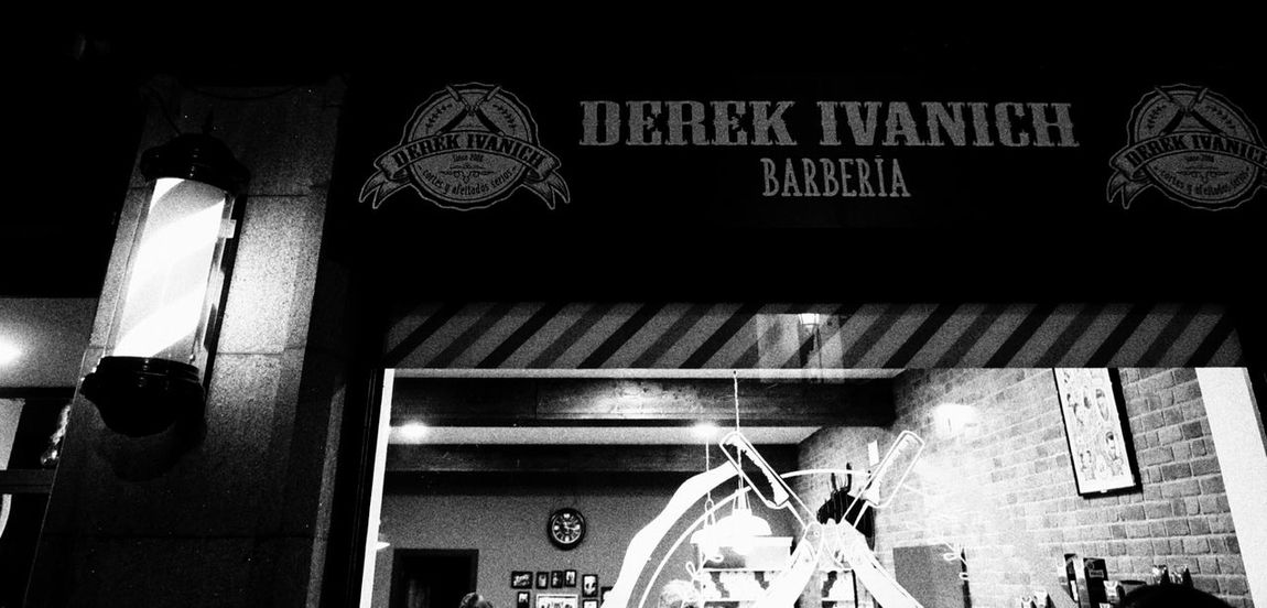 Low Angle View Night Illuminated Retro Styled Fashion Barber Barberstyle Barbershop City Life Street Photography City Street Selective Focus Black And White Photography Monochrome Photography Blackandwhite Photography Huawei P9 Photos