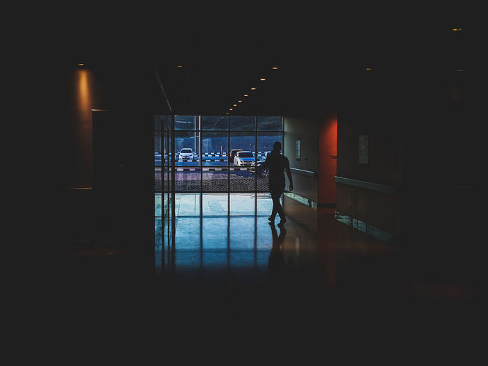 EyeEm Selects Streetphotography Great Atmosphere Pastel Power Walking Around Smartphonephotography Nightphotography darkness and light Dim Light WeekOnEyeEm Reflection Having Fun Light And Shadow Light In The Darkness Urbanphotography City Water Architecture Built Structure Airport Departure Area