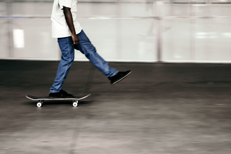 Skateboard Balance One Person Casual Clothing Motion Low Section Sports Equipment Skill  Sport Day Side View Skateboard Park Jeans Leisure Activity Human Leg Mid-air Indoors  Lifestyles Real People
