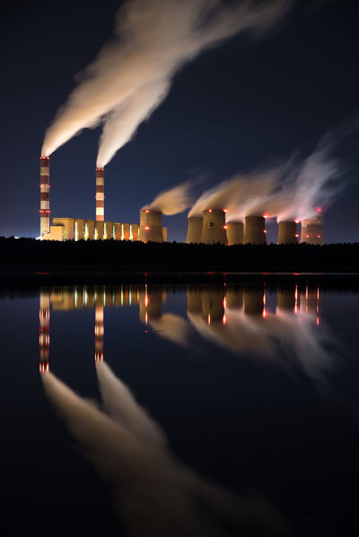 EyeEmNewHere Air Pollution Architecture Building Exterior Built Structure Chemical Plant Cloud - Sky Cooling Tower Emitting Environment Environmental Issues Fumes Industry Nature Night No People Outdoors Pollution Power In Nature Reflection Sky Smoke - Physical Structure Smoke Stack Water