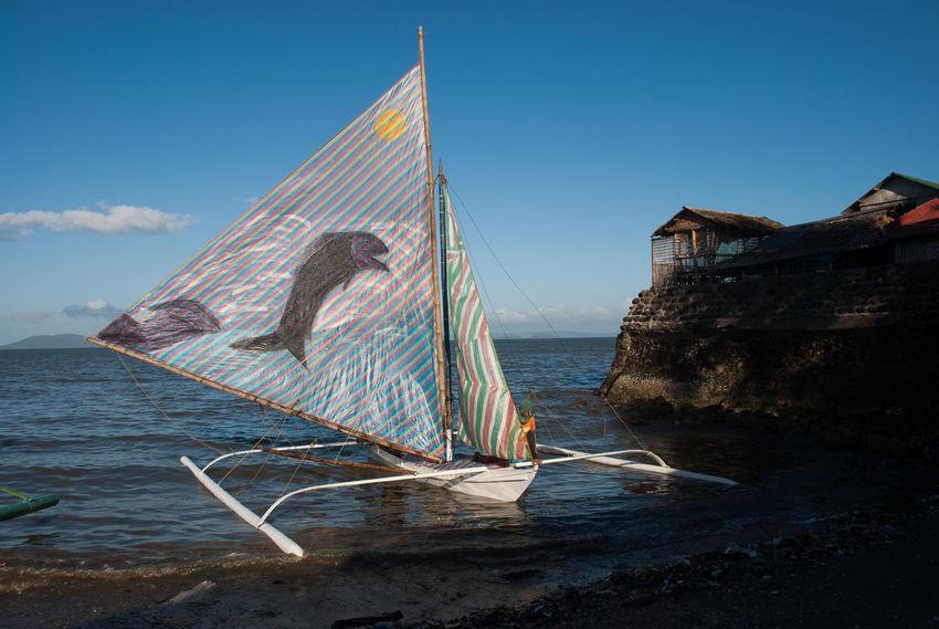 Bacolod Beach Life EyeEm Best Shots Eyeem Philippines Sky And Clouds The Week On EyeEm Blue Sky Boats Day Eyeem Bacolod Ocean Orange Color Outdoors People Sky Streetphotography