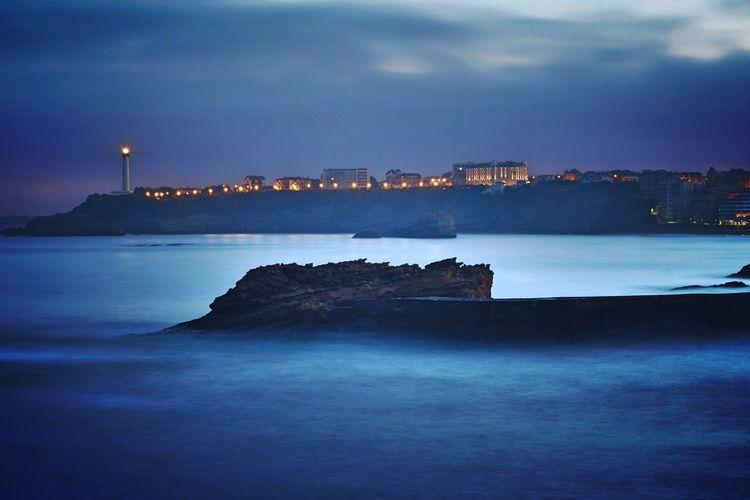 City on seashore at night