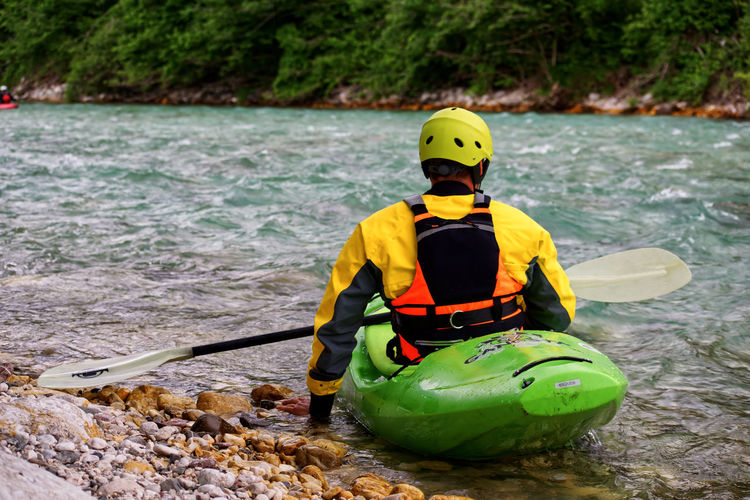 kayaking in slowenia, Soča river Kajak Kayaking Nature Riverside Safety First! Soca River Adventure Blue Water Headwear Helmet Kayak Leisure Activity Lifestyles Nature Nautical Vessel One Person Real People Rear View River Safety Slowenia Sport Sports Vacation Water #FREIHEITBERLIN The Great Outdoors - 2018 EyeEm Awards EyeEmNewHere Summer Sports Be Brave A New Beginning 50 Ways Of Seeing: Gratitude A New Perspective On Life Moments Of Happiness