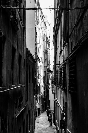 Narrow alley amidst old buildings in city