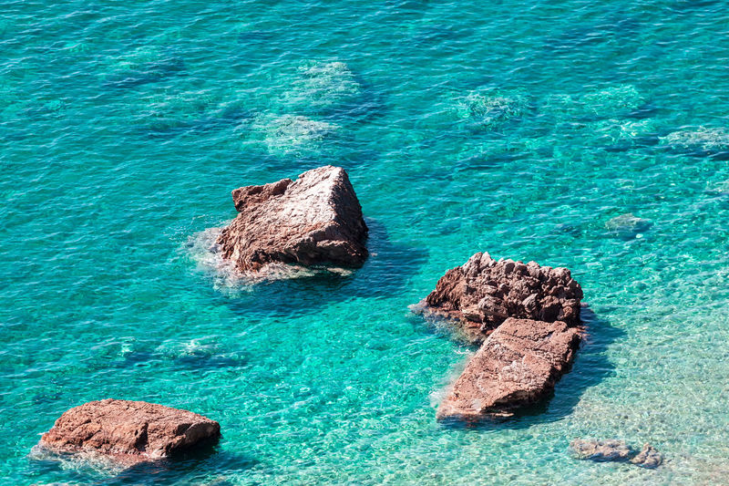 Turquoise water with natural rocks in the sea