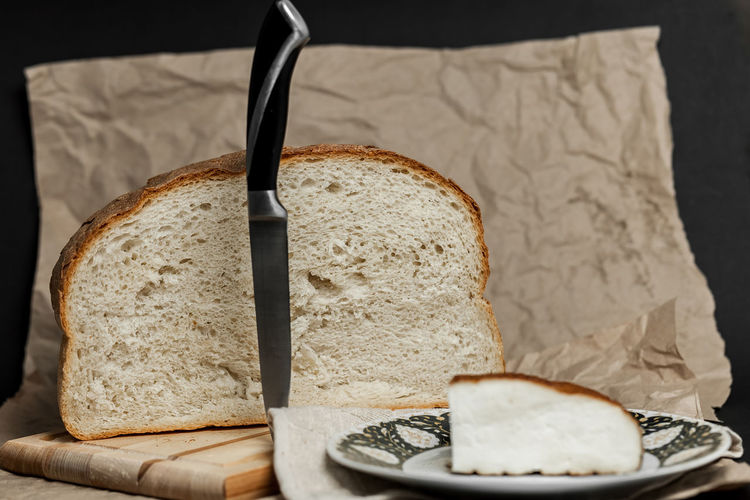 Smoked cheese on a cutting board and cut bread. Next to it lies a knife and a towel. Photo in soft brown tones. Object photo, no people. Still life. Breakfast Eating Food And Drink Freshness Homemade Knife Morning Smoked Textured  Wood Bread Brown Cheese Close Up Close-up Cutting Board Eat Food Handmade No People Object Paper Ready-to-eat Still Life Texture