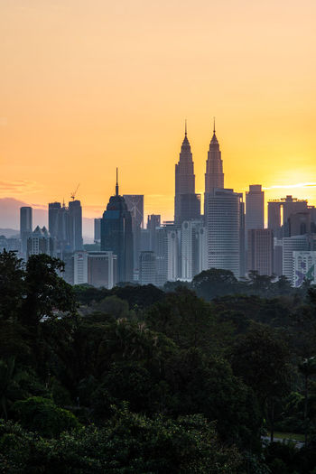 View of buildings in city during sunset