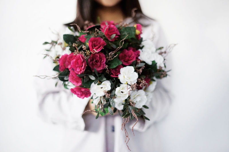 Close-Up Of Woman Holding Bunch Of Flowers