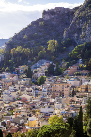 Architecture Building Exterior Built Structure Cliff Cloud - Sky Community Crowded Day Development High Angle View House Housing Settlement Mountain No People Old Town Outdoors Place Of Worship Rooftop Scenics Sky Taormina Taormina And Etna Town TOWNSCAPE Tree