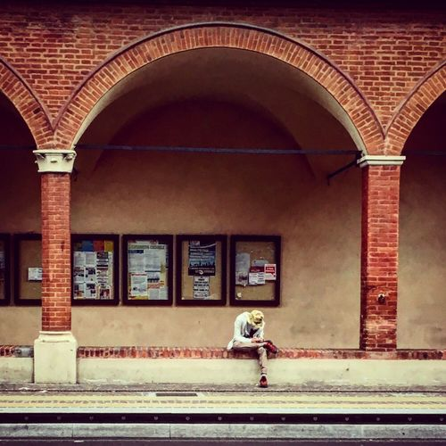 Bologna Sitting Man Pórtico Colonnade Italy People And Places
