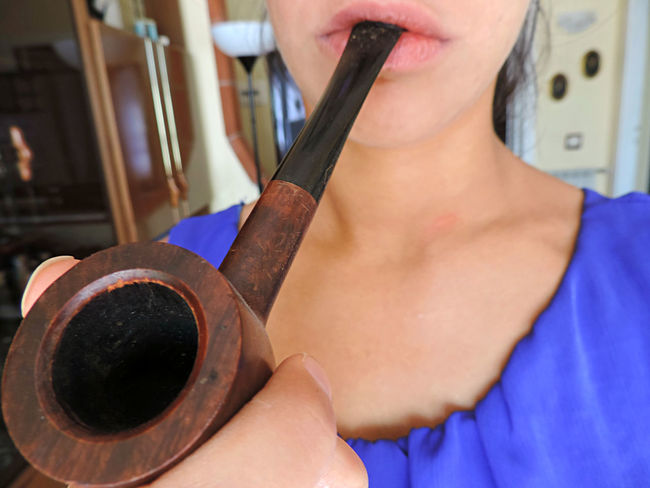 Beauty Blue Brown Indoors  Lifestyles Lip Lips No Smoking Old Person Pipe Pipe Smoking Pipes Smoke Smoking Unhappy Unhealthy Unhealthy Lifestyle Wood Wood - Material Young Women