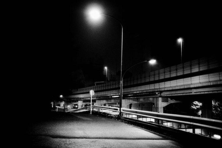 Illuminated train against sky at night